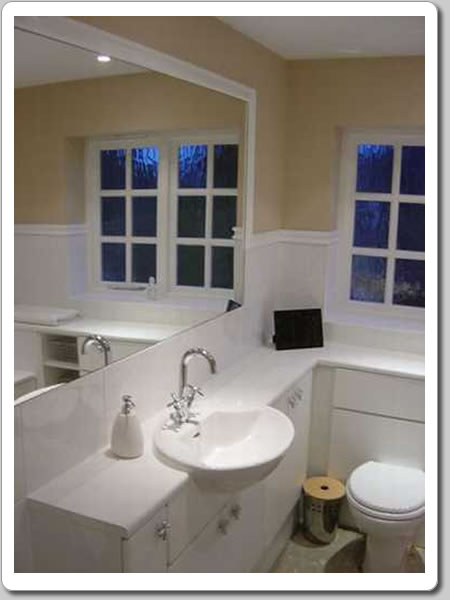 Photo of functional bathroom with concealed toilet cistern, fitted bathroom units and clever use of space